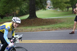 Katie biking at the Half Full Triathlon